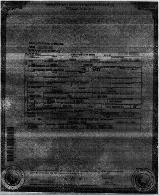 unbrauchbare Ansicht einer texanischen Geburtsurkunde (mit Handy ohne Blitz fotografiert)